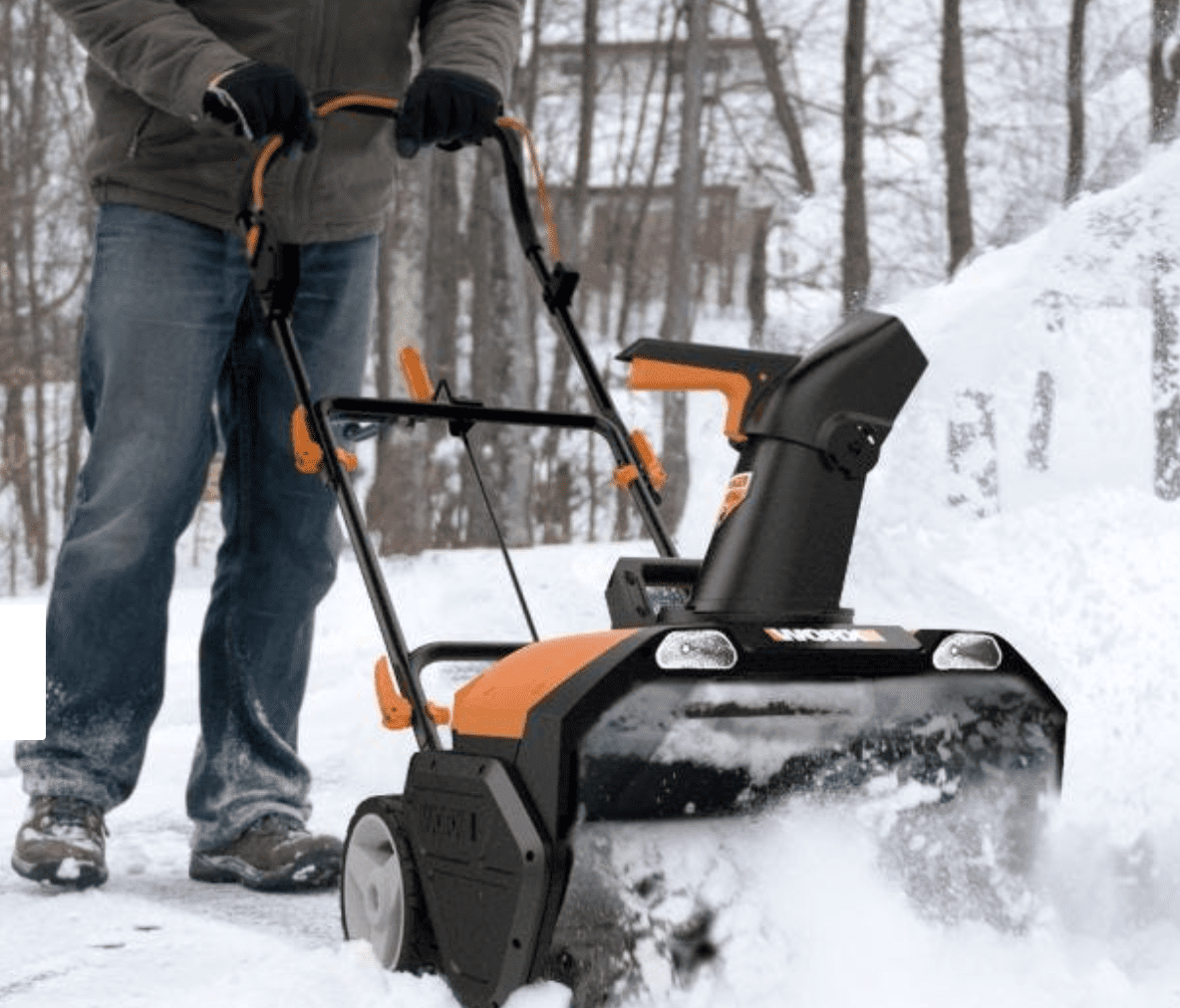 person using Worx cordless snow blower to remove snow