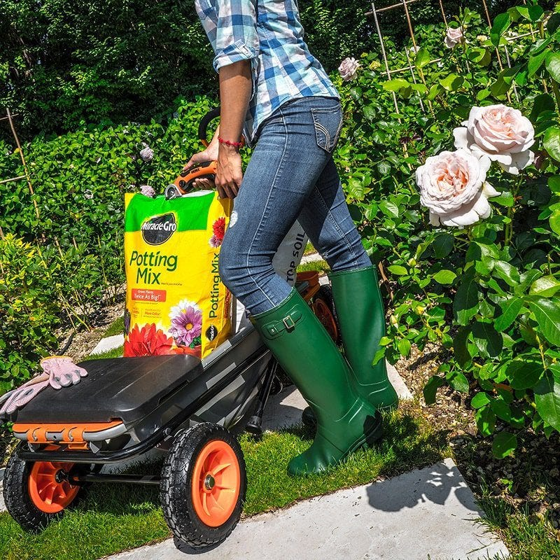 woman using Worx Aerocart farden cart with seat for planting flowers