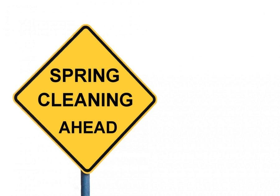 """yellow road sign that says """"spring cleaning ahead"""""""